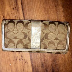 Coach must have mono pattern with gold accent.